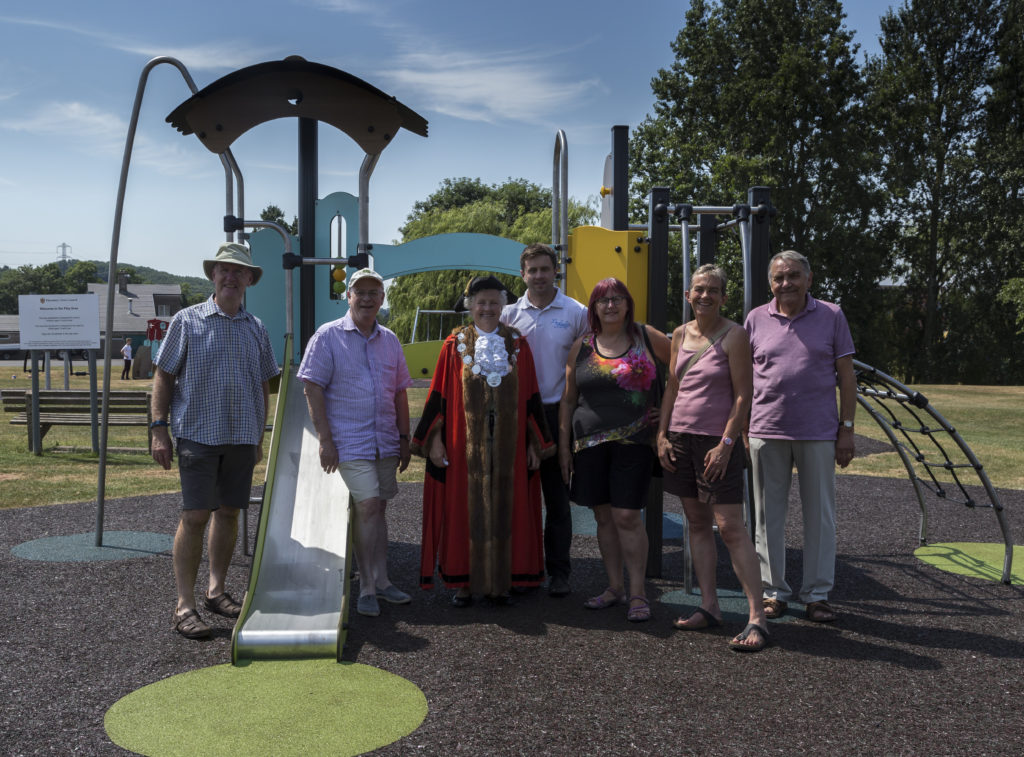 Councillors in front of play equipment