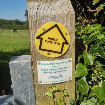 Footpath sign on a gatepost