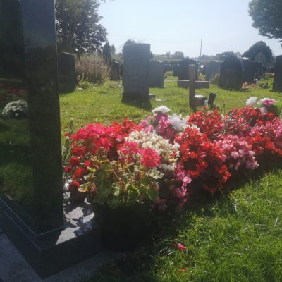 Flowers on a grave - Click to open full size image
