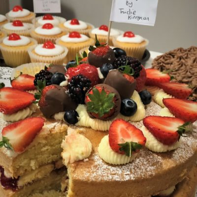 A variety of cakes and fruit
